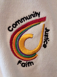 Close-up of embroidered logo on polo shirt